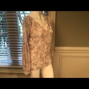 WHBM blouse, feminine with modern design. Size 0